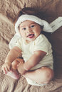 Lovable baby portrait of a months in funny pilot hat toned image Royalty Free Stock Photo