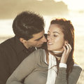 Love and affection between a young couple at the beach in sunny day selective focus with shallow dof Stock Photos