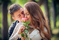 Love and affection between a young couple at the park Royalty Free Stock Photo