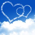 Love is in the air with clouds and blue background Royalty Free Stock Images