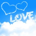 Love is in the air with clouds and blue background Stock Photography