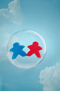 Love is in the air couple figurines floating a soap bubble sky Royalty Free Stock Photos