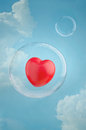 Love is in the air red heart floating a soap bubble sky Stock Photo