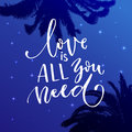 Love is all you need, Inspiration calligraphy on starry night background with palm silhouettes