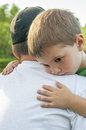 Love for big brother little boy hugs his older Stock Photos