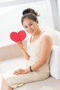 Love card for mom vertical portrait of a happy woman with a heart in hands Royalty Free Stock Image
