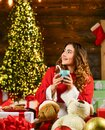 She love Christmas. feeling cosy. love candy cane. best christmas recipes. happy girl drink milk with xmas cookies Royalty Free Stock Photo