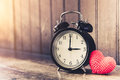 Love clock vintage tone timed 3 o`clock. Royalty Free Stock Photo