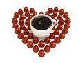 Love coffee capsules surrounding a cup forming a heart Stock Photography