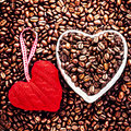 Love coffee at valentine s day roasted coffee beans with red he heart over background wedding holiday Stock Image