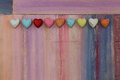 Love colorful hearts on painted board message space with wooden copy space Stock Photo