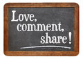 Love comment share social media concept on a vintage slate blackboard Royalty Free Stock Photo