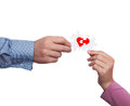 Love concept close up of hands holding puzzle pieces of hearth as Royalty Free Stock Images