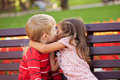 Love concept couple of kids kissing loving each other hugging and Royalty Free Stock Images