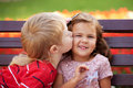 Love concept couple of kids loving each other hugging and kissing Royalty Free Stock Image