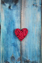 Love concept. Red heart over blue rustic wooden background wooden background. Valentine's Day  poster or postcard design. Vintage Royalty Free Stock Photo