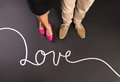 Love concept simple with feet and chalk drawn symbols happy valentines card Royalty Free Stock Images