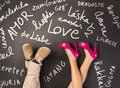 Love concept simple with feet and chalk drawn symbols happy valentines card Stock Image