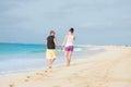 Love couple on the beach at náhrené sandy beach with blue sea cabo verde sal snata maria exotic Royalty Free Stock Photo