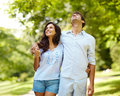 Love couple enjoying themselves in park Royalty Free Stock Photo