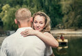 Love couple near the pond Royalty Free Stock Photo