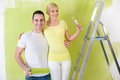 Love couple painting home young together Stock Photo