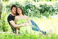 Love couple portrait of embracing outdoor in park looking happy Stock Photography