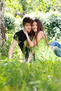 Love couple portrait of embracing outdoor in park looking happy Royalty Free Stock Images