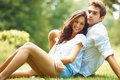 Love couple spending time together in park Royalty Free Stock Photo