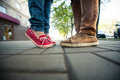 Love couple standing on the sidewalk legs man and woman Stock Photos