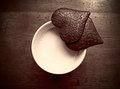 Love cup of milk and two heart shaped pieces of chocolate Royalty Free Stock Photo