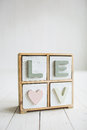 Love decorative letters on the white wooden background Royalty Free Stock Photo