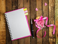 Love diary - blank spiral notebook and pen on wood Royalty Free Stock Photo