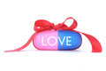 Love dose drug in the form of a capsule tied with a decorative ribbon bow Stock Photo