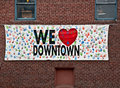 We Love Downtown Sign On Brick...