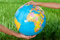 Love the earth hands hold up a globe Stock Photography