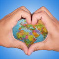 Love earth hands holding as heart Stock Image