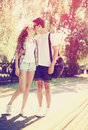 Love, fashion and people concept - summer stylish pretty couple Royalty Free Stock Photo