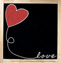 Love frame on blackboard freehand drawing with red heart and copy space chalkboard in wood isolated over white background Royalty Free Stock Image