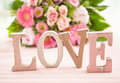 LOVE in front of flower bouquet Royalty Free Stock Photo