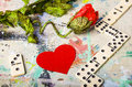 Love is a game red heart poppy flower and bricks of domino lying on the artistic background photo depicts complicated stories as Stock Images