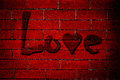 Love Graffiti on Red Brick Wall Stock Photo