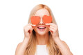 Love is a great feeling beautiful young blond hair woman holding heart shaped valentine cards in front of her eyes and smiling Royalty Free Stock Images