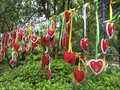 Love hanging from a chain lovers hang hearts together at butterfly spring in the dali region of yunnan china Stock Photo
