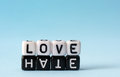 Love and hate text concept on white black dices Stock Images