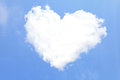 Love heart from clouds with blue sky background Stock Images