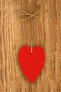 Love heart hanging on wooden texture background, valentines day