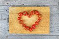 Love heart idea food tomato composition on wood background Royalty Free Stock Photography