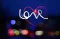 Love heart light writing colorful bokeh night lights with Royalty Free Stock Image