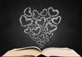 Love heart shape sign on blackboard popup from book Royalty Free Stock Images